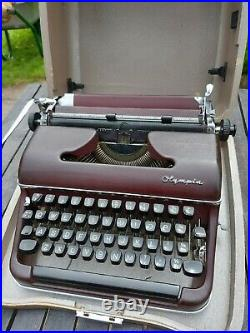 Vintage Olympia SM2 Portable Typewriter in Case. Very Rare Colour Burgundy